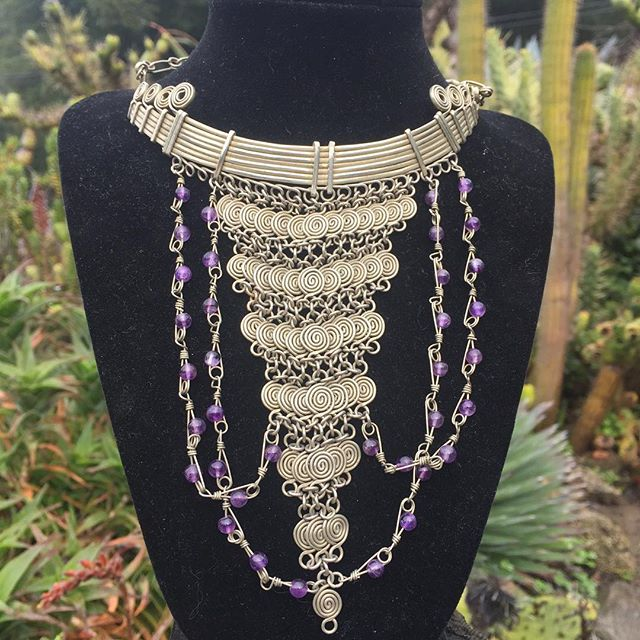 #Handmade mixed-metal wire & #amethyst #baroque-inspired necklace by Kaj Bratt now available in our online shop at bigsurgardengallery.com! #Chainmail #spirals symbolize the journey of life from inner soul to outer consciousness. Amethyst is associated with royalty and #prosperity. A magical #oneofakind statement piece for the queen in your life. #BigSurArt #BigSurJewelry #OneOfAKindJewelry #OOAK #WearSomeArt #BigSurGardenGallery