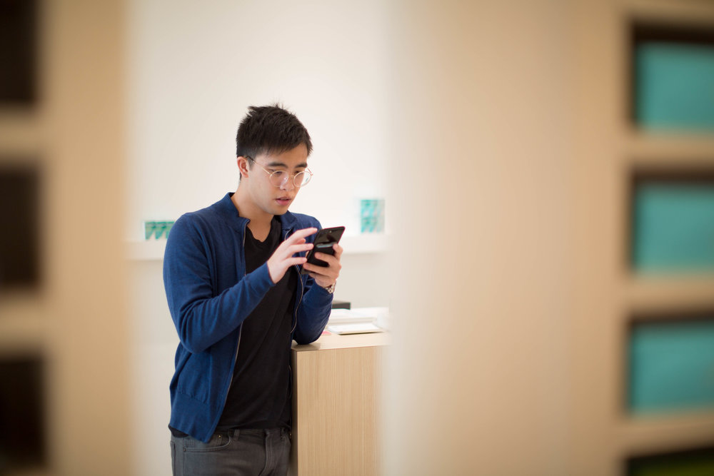 Photo of Tony Phung, Managing Partner. A great example of a photo showing focusing in the far distance provides clarity, while the objects up close are not in focus.