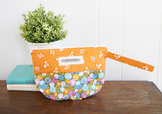 Wrist bag created by LiveLaughSew on Etsy, using Josephine Kimberling's Field Day fabrics