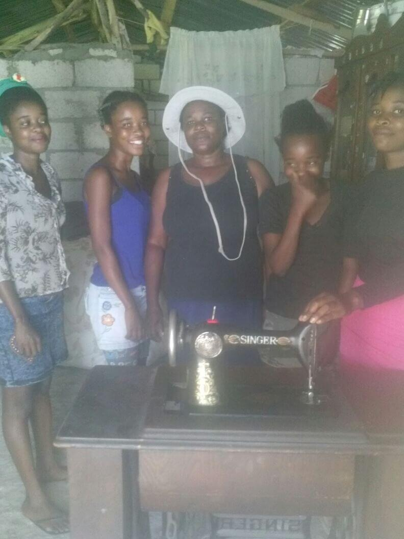 Some of our beaders in Montrouis, Haiti with the pedal sewing machine.
