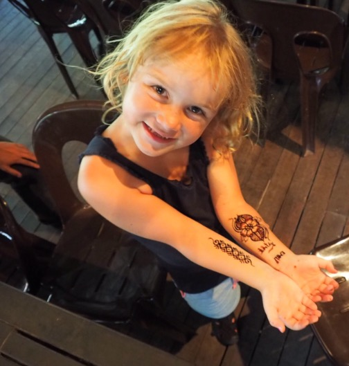 Loving her henna tattoos!