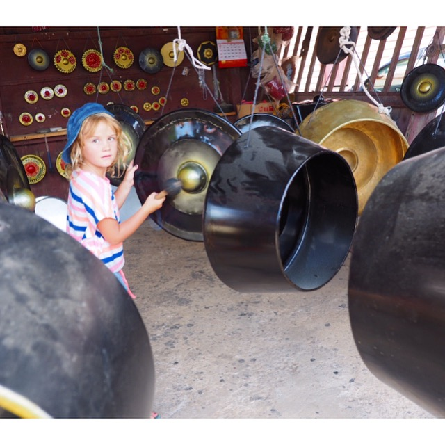 Emmie having a go at playing the gongs