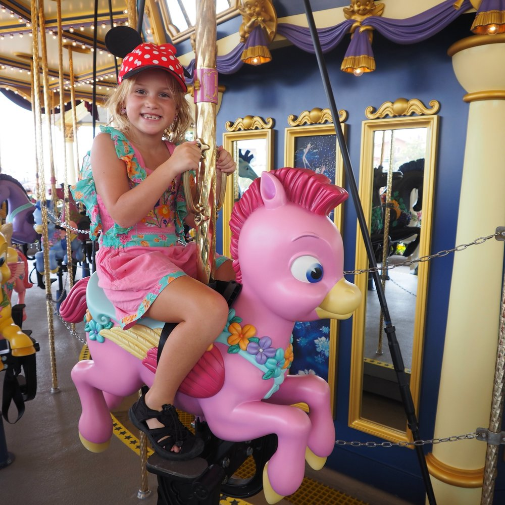 Emmie loved these cute horses on the Fantasia Carousel