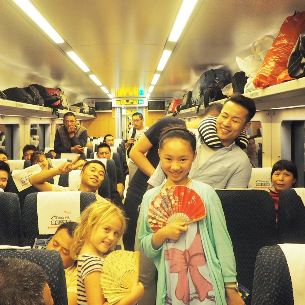 We love riding the trains in China, Emmie always makes friends!