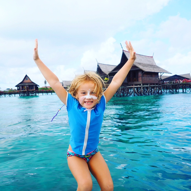 Jumping off the dive boat at Mabul Island in Malaysian Borneo
