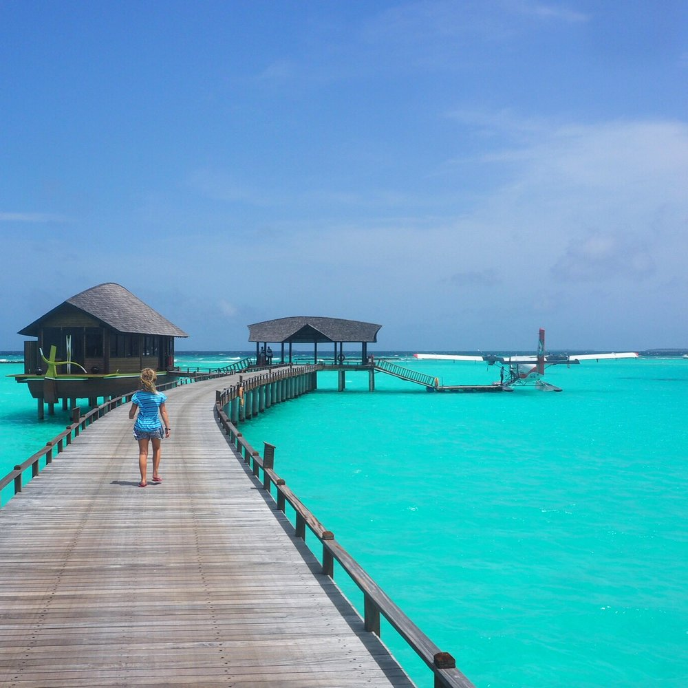 Walking out to the plane at the Sun Siyan Iru Fushi - yes the water is that colour!