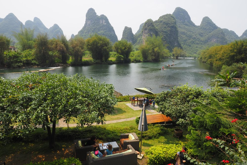 Seriously beautiful Yangshuo - Emmie doing some schoolwork (hhahah I bet she wasn't)