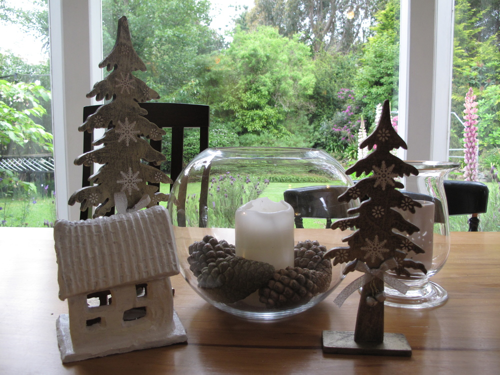 Christmas tabletop decorations - pinecones and white house