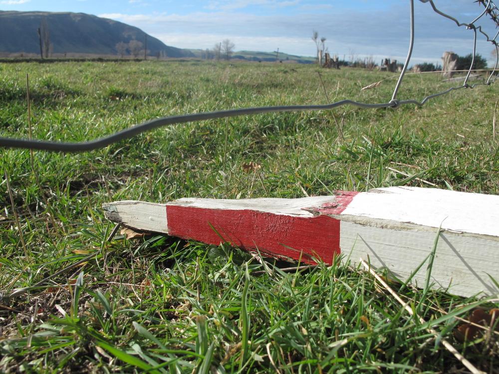 Broken red wooden road side markers