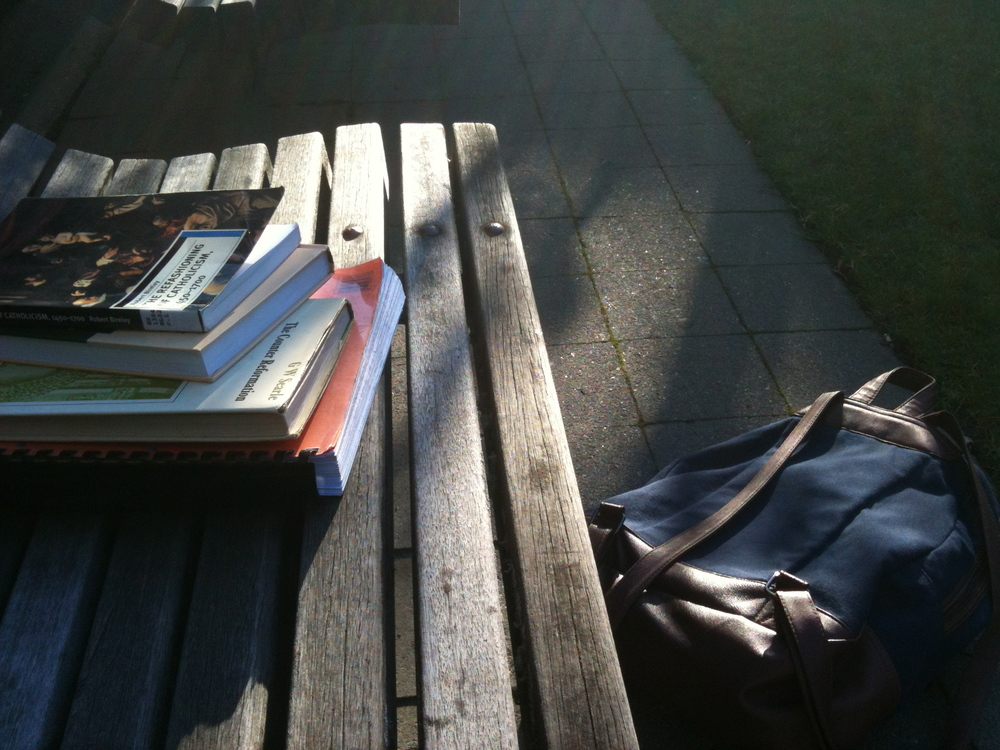Books on a wooden bench at University