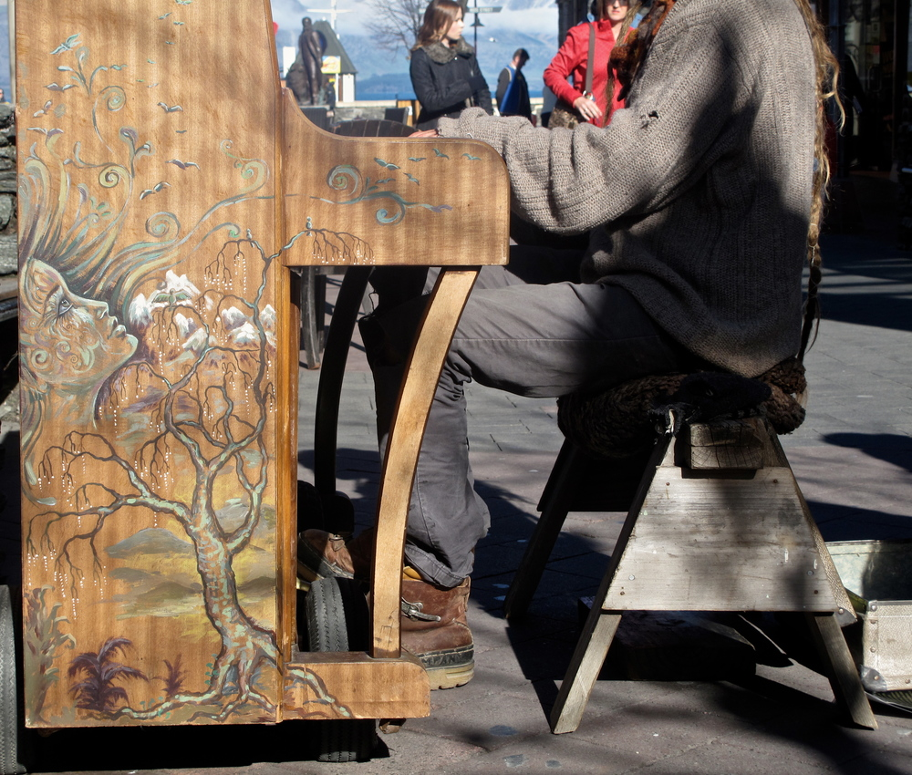 Painted piano of a busker in Queenstown