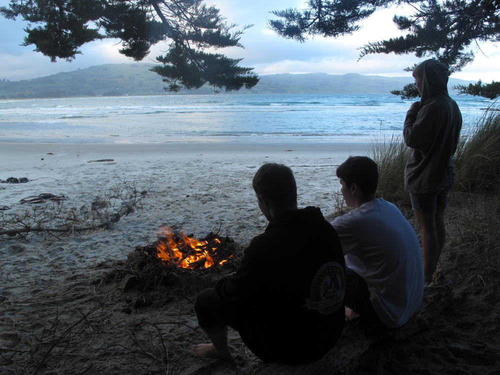 Gathering around a beach bonfire Purakaunui
