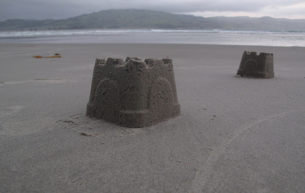 Two sandcastles on the beach