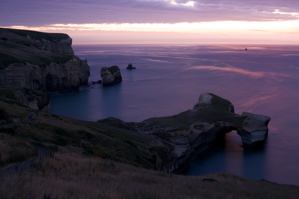 Tunnel beach before sunrise at dawn - purple sea