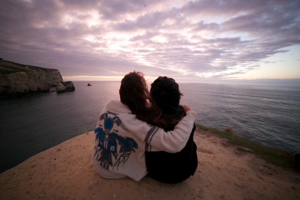 Meditating together at Tunnel Beach NZ