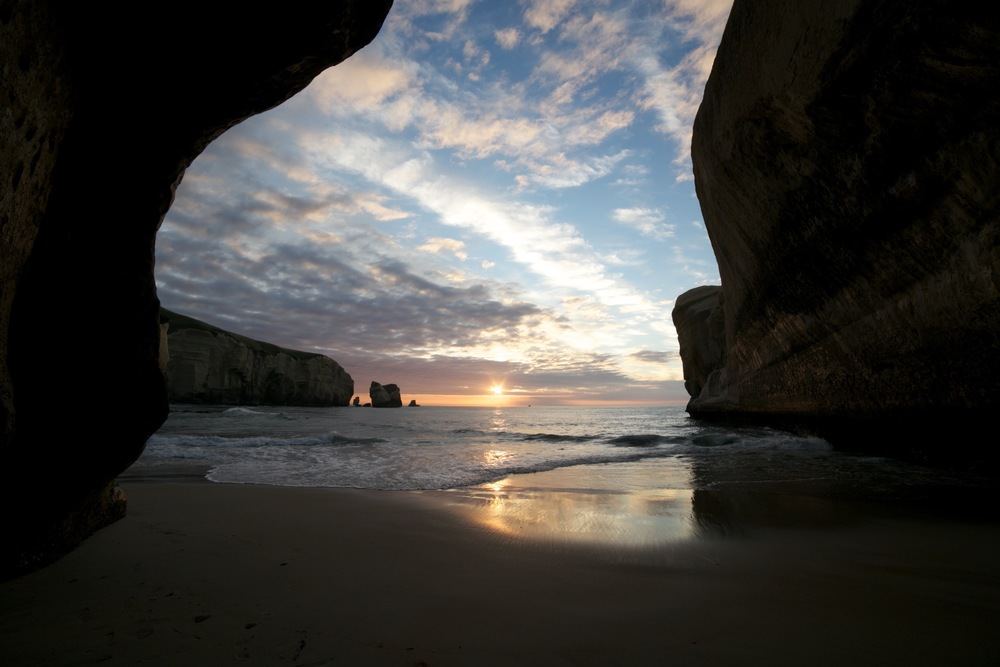 Tunnel Beach Cave at sunrise NZ