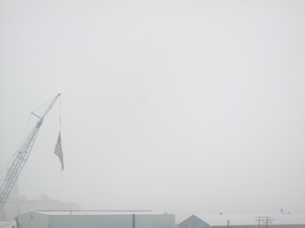 American flag in a whiteout of snow in Colorado