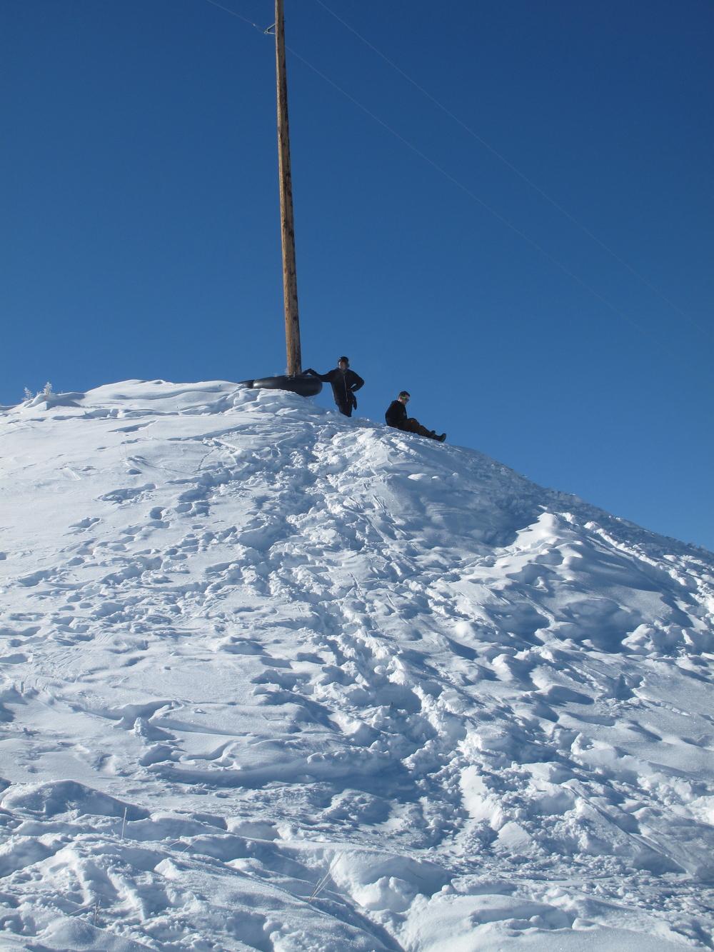 Urban sledding on snowy hill in Colorado