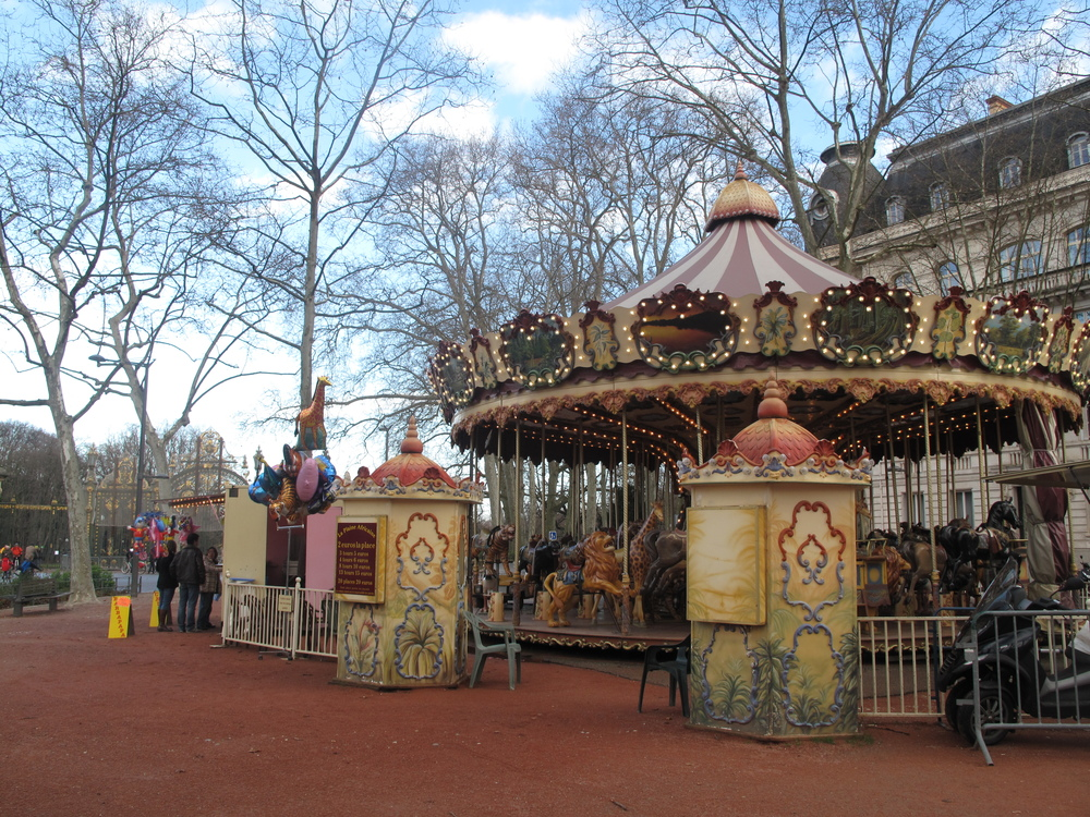 Pink carrousel outside Parc de la Tête d'Or, Lyon, France