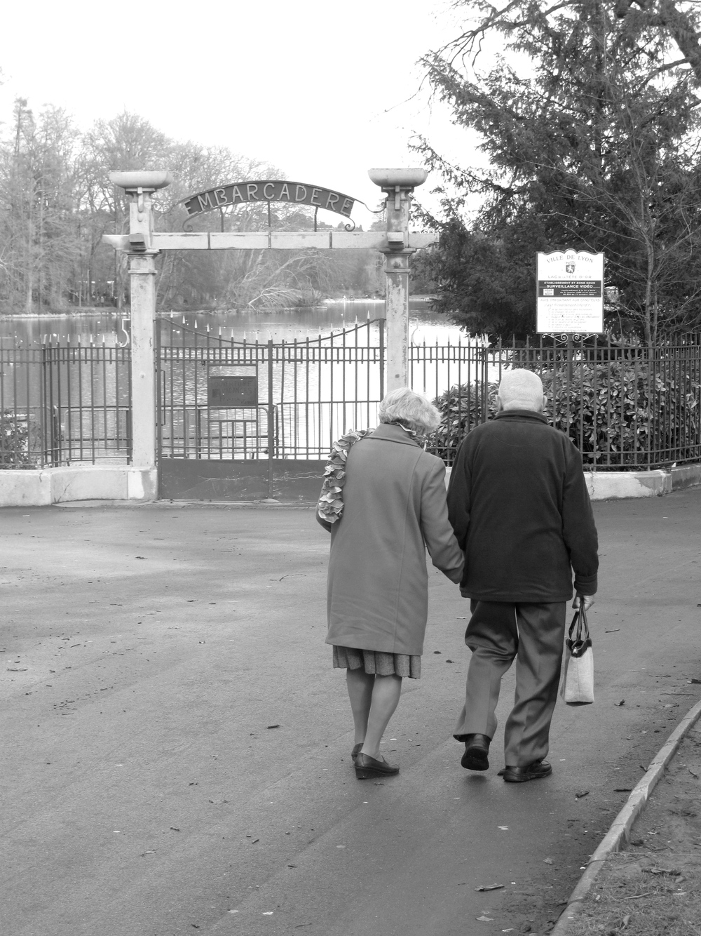 Old French couple walking hand in hand, Parc de la Tête d'Or
