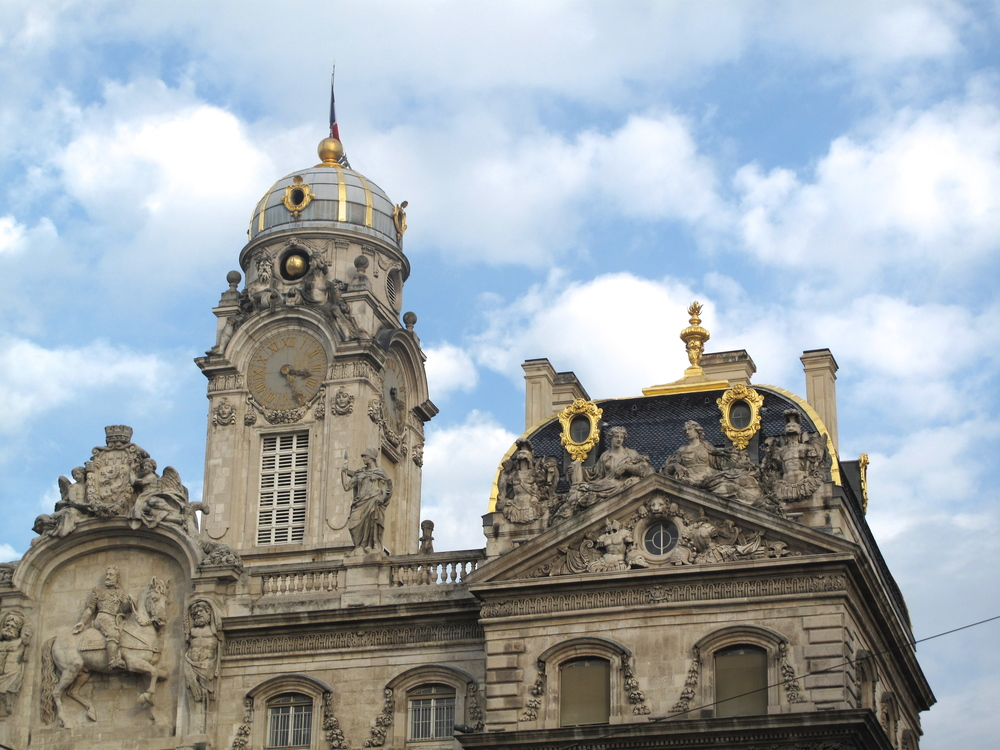 Hôtel de Ville gold accents on a mansard roof, Lyon