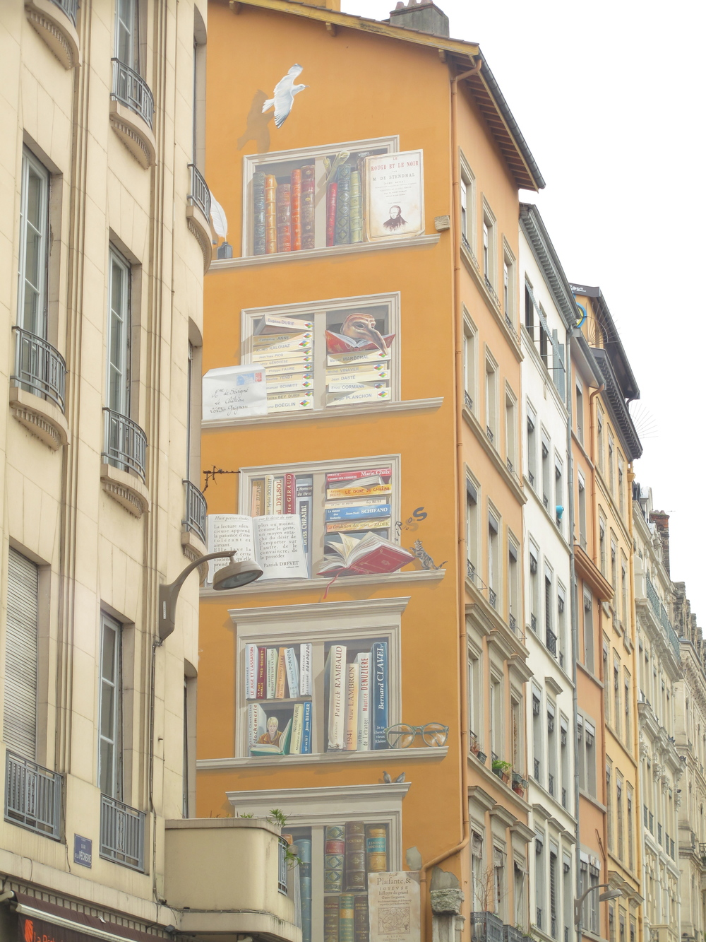 Trompe l'oeil wall of bookshelves in Lyon, France