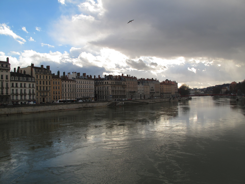 The river Saône in Lyon with clouds reflecting on the water