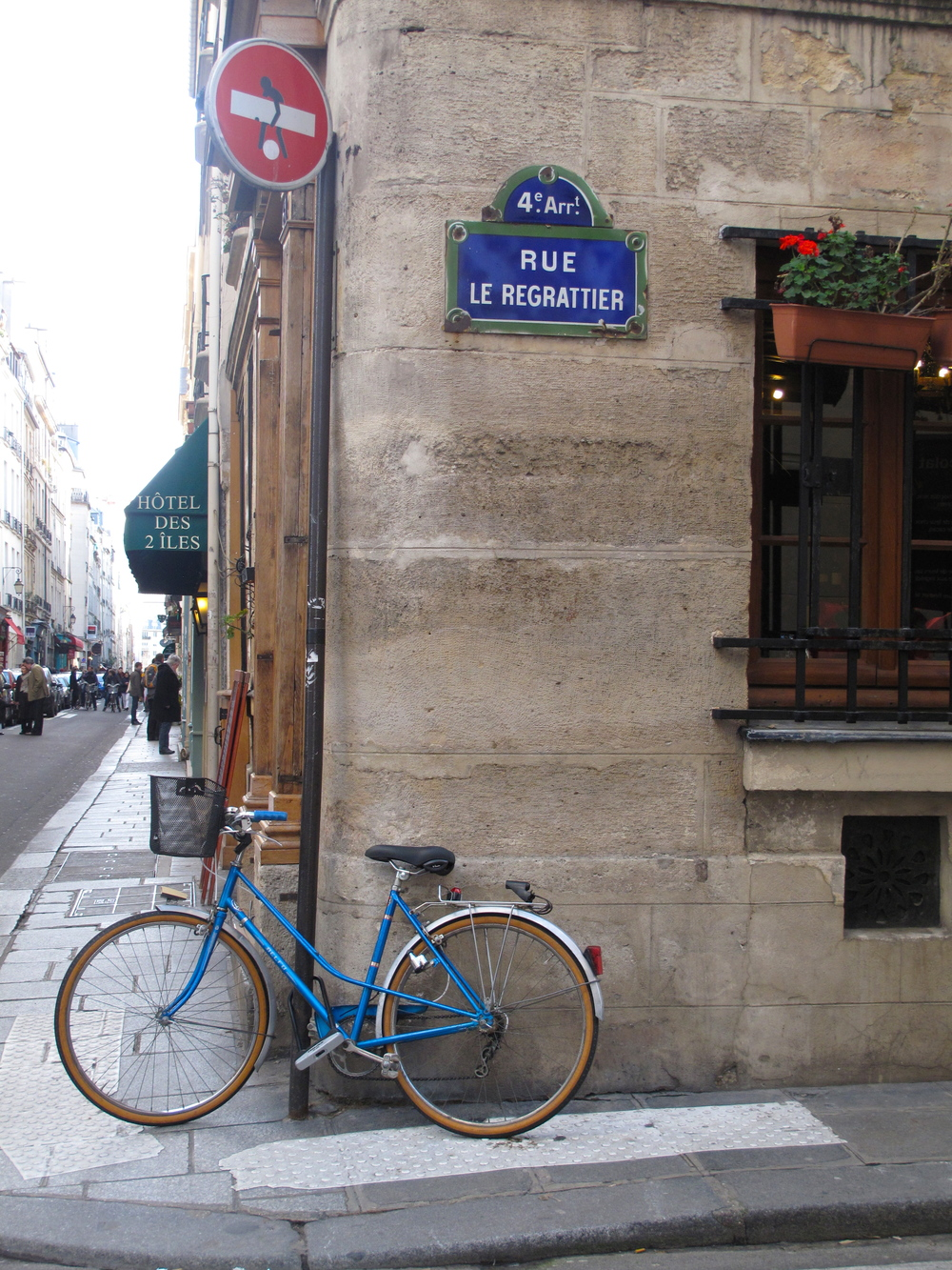 Quaint roads, signs and blue bicycles on Île Saint Louis, Paris