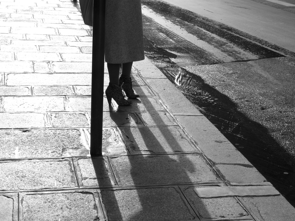 Women in heels and 1940's skirt on the cobbled streets of Paris