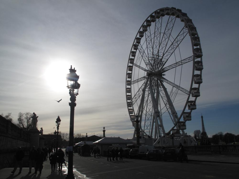 Roue de Paris ferris wheel silhouette in the sun