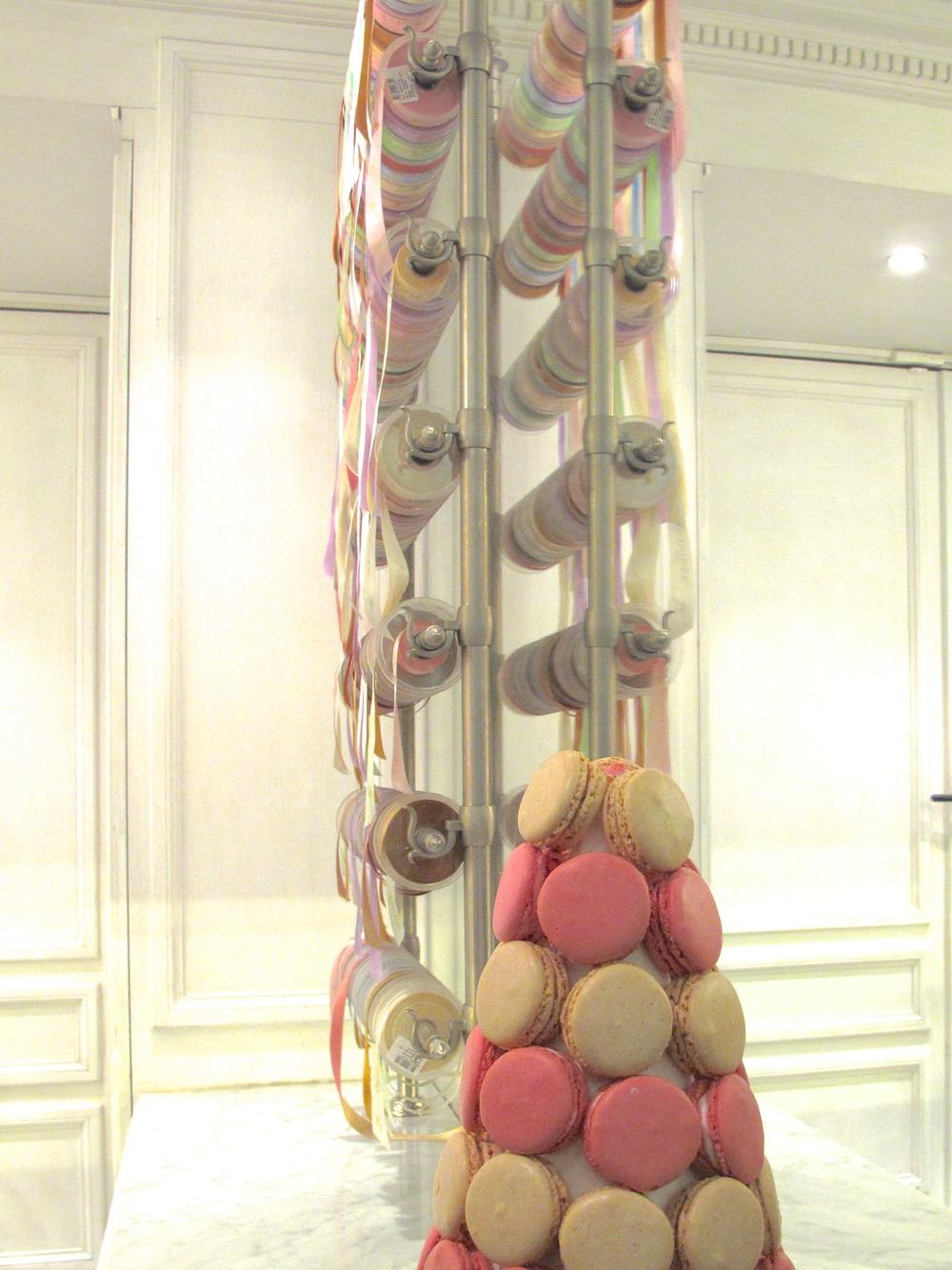 Display of macarons and ribbons at Ladurée, Paris