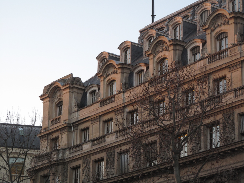 Paris architecture glows pink in the evening sun at dusk