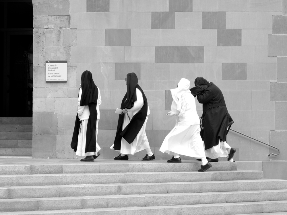 Nuns battling the wind at the monastery of Montserrat, Catalonia