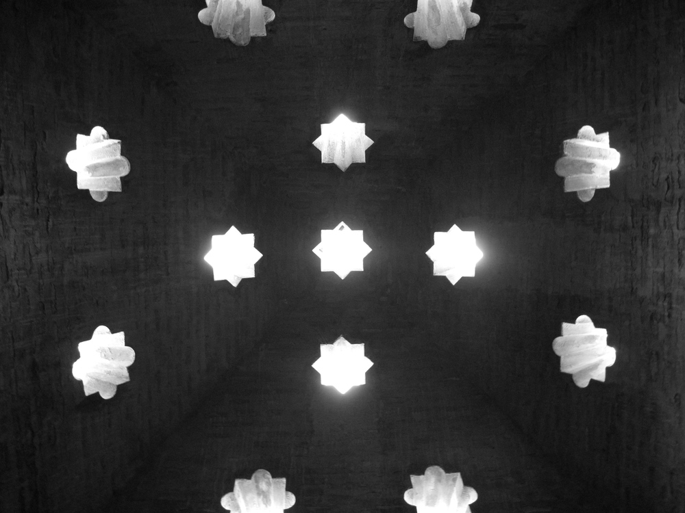 star shaped holes in ceiling of a medieval bath-house, in the Alhambra