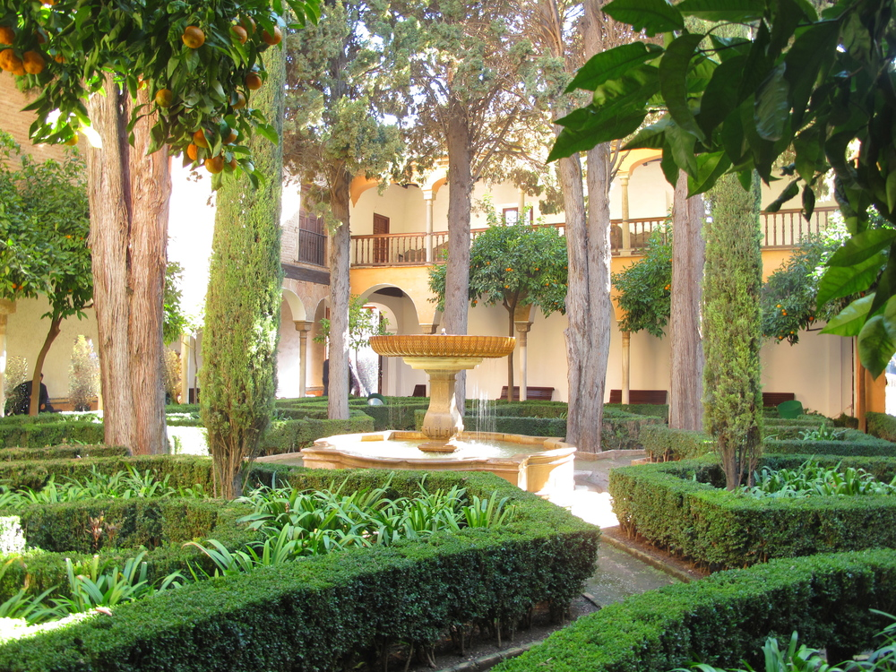 Courtyard filled with greenery and a fountain at the Alhambra