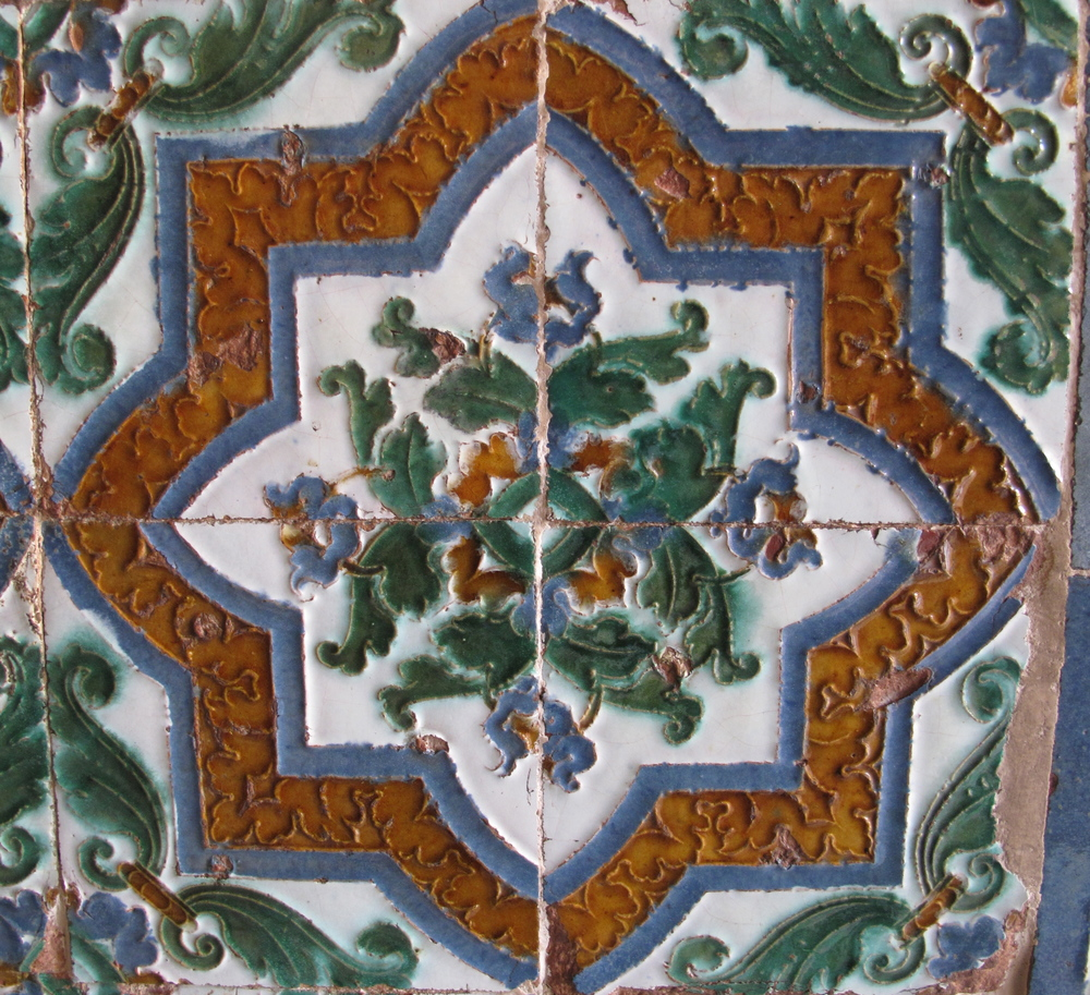 Tiled patterns on the walls - green and brown and white