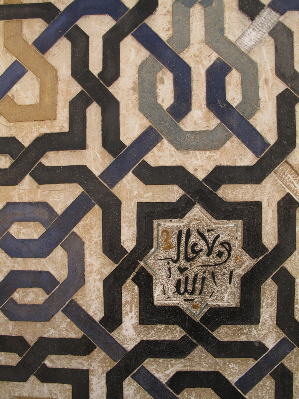 a geometric pattern in the tiles of the Alhambra
