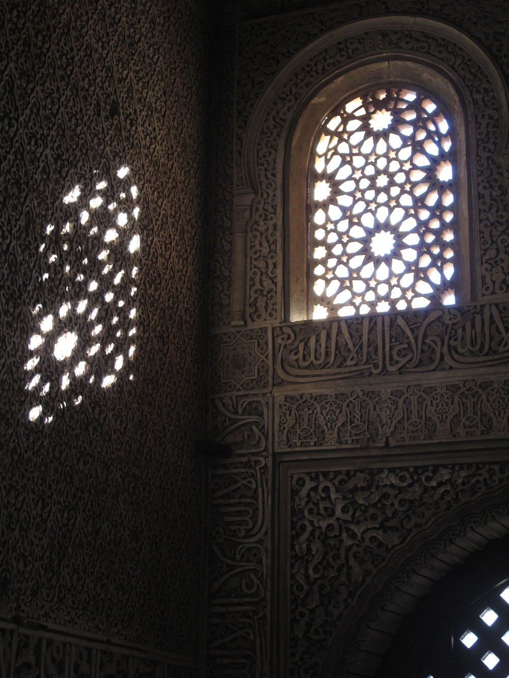 Windows with traceries at the Alhambra, shadows and light in patterns on the wall