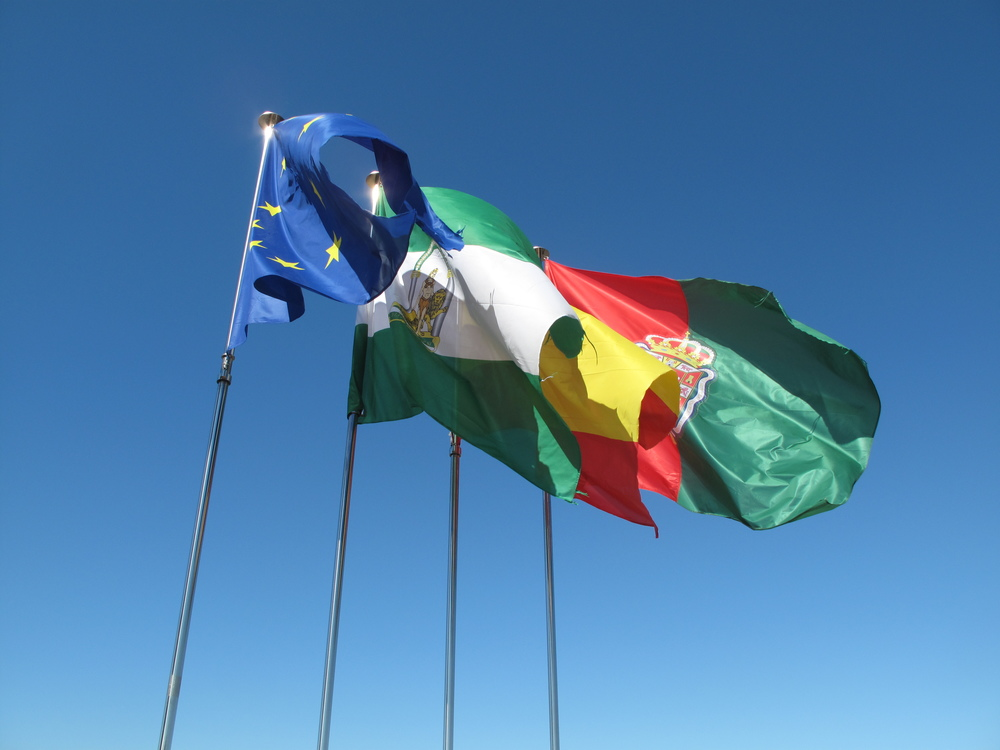 colourful Spanish flags flying in the breeze and blue sky