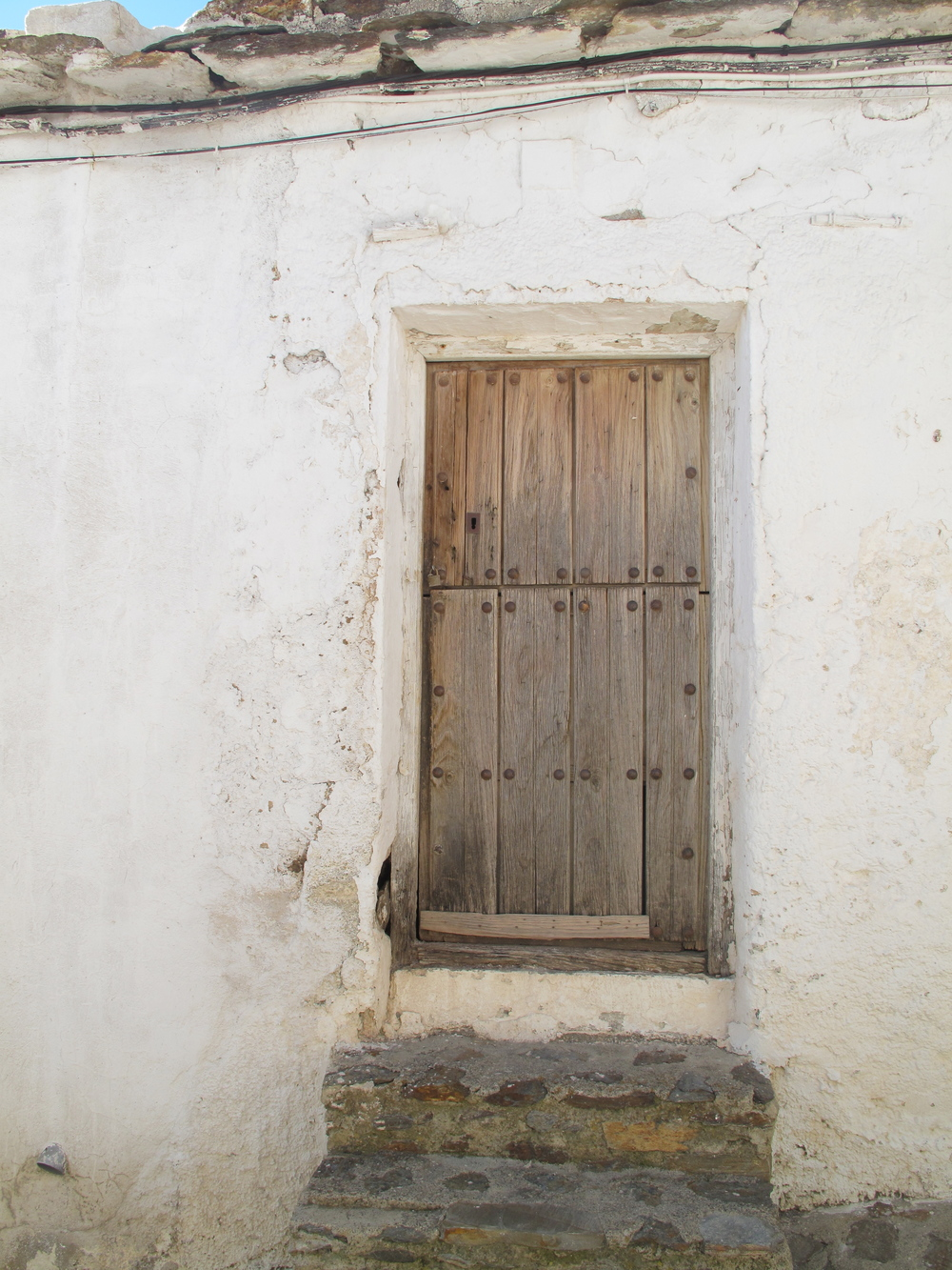 Little rustic wooden door in a tiny mountain town
