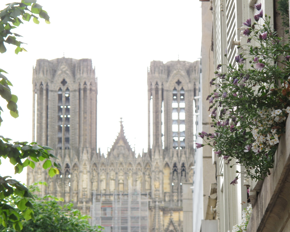 Reims Cathedral, seen from a distance, with flowers in the foreground