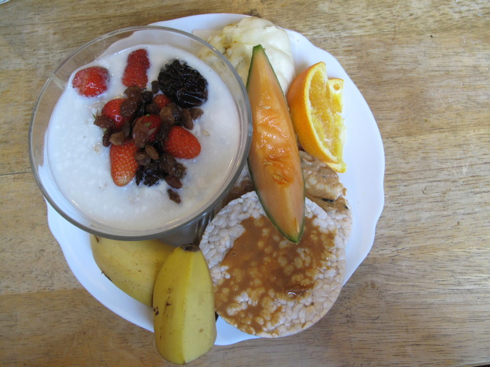 Breakfast meal at Plum Village - porridge, fresh fruit, nuts and prunes