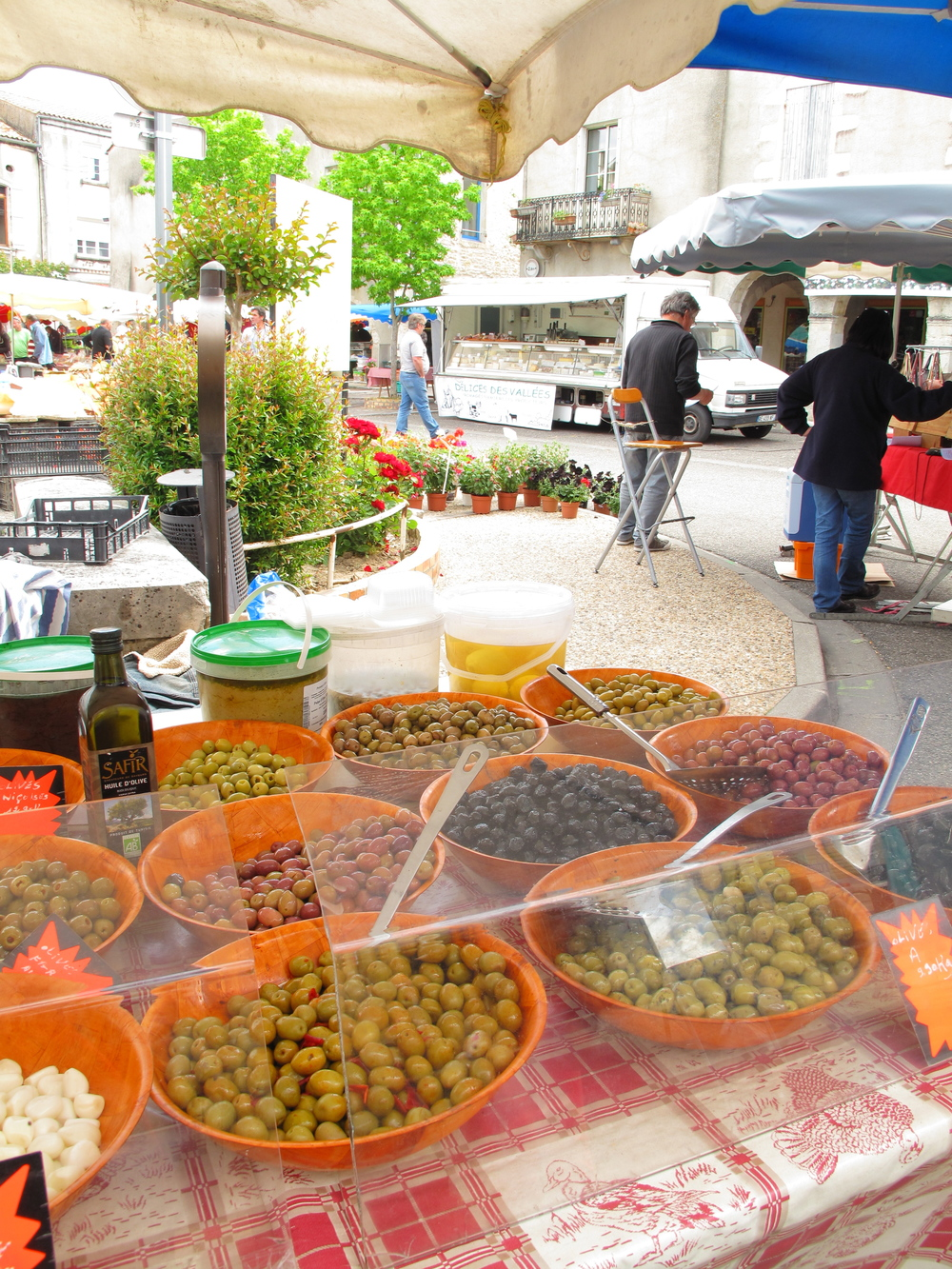Market place at Duras, with a stall selling all types of olives!