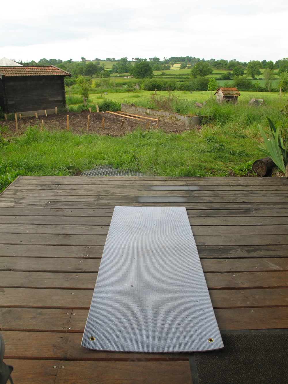 Yoga on the porch of my tiny log cabin, in the beautiful morning of Brenazet, France