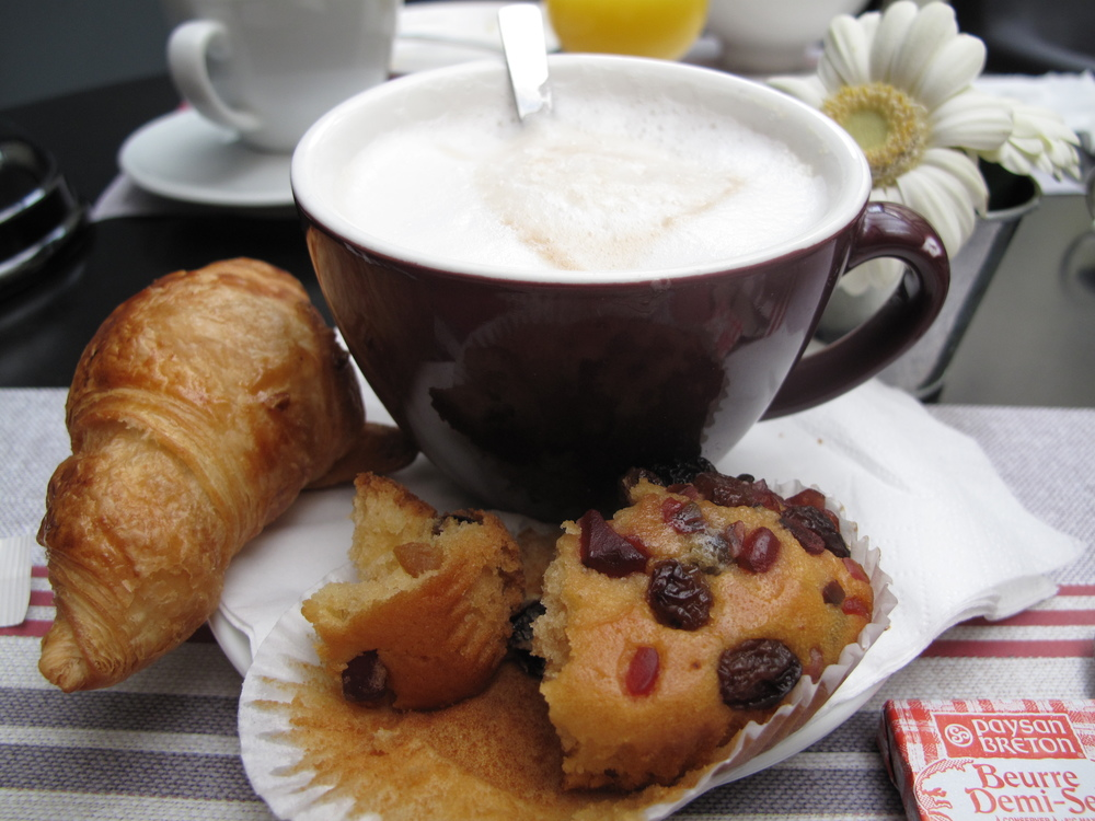 A typical French breakfast - croissants, pastries, coffee and juice.