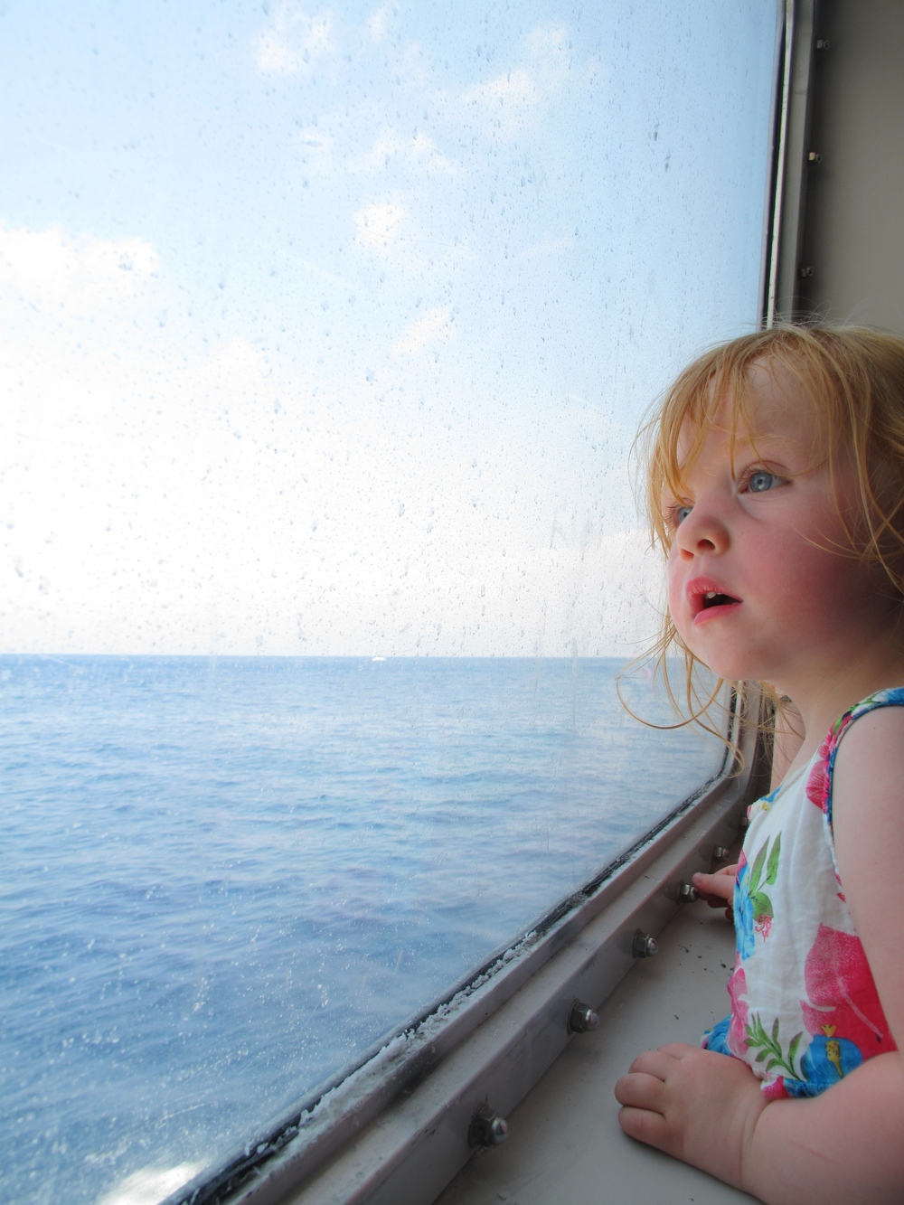 An Italian cherub baby looking out at the ocean