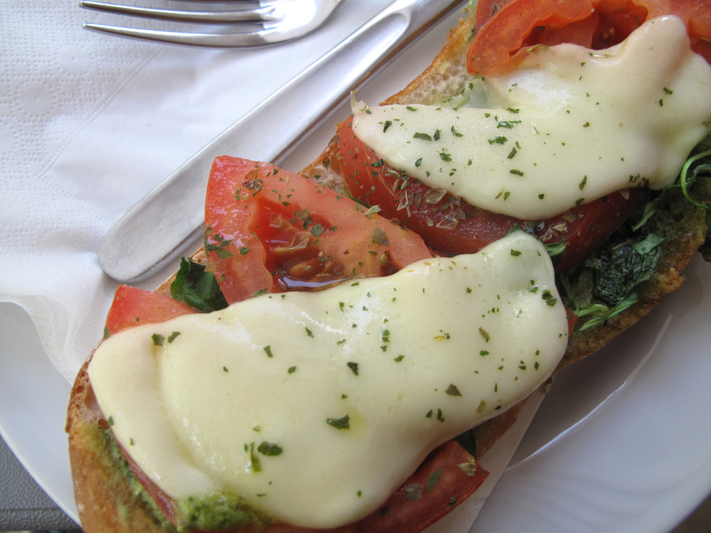 Italian bruschetta with mozzarella cheese, tomatoes, and oregano