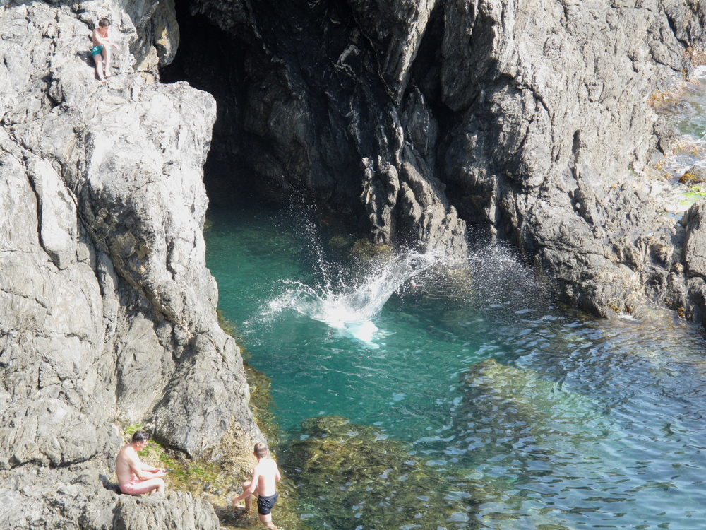 Cliff jumping into the sea of the Cinque Terre