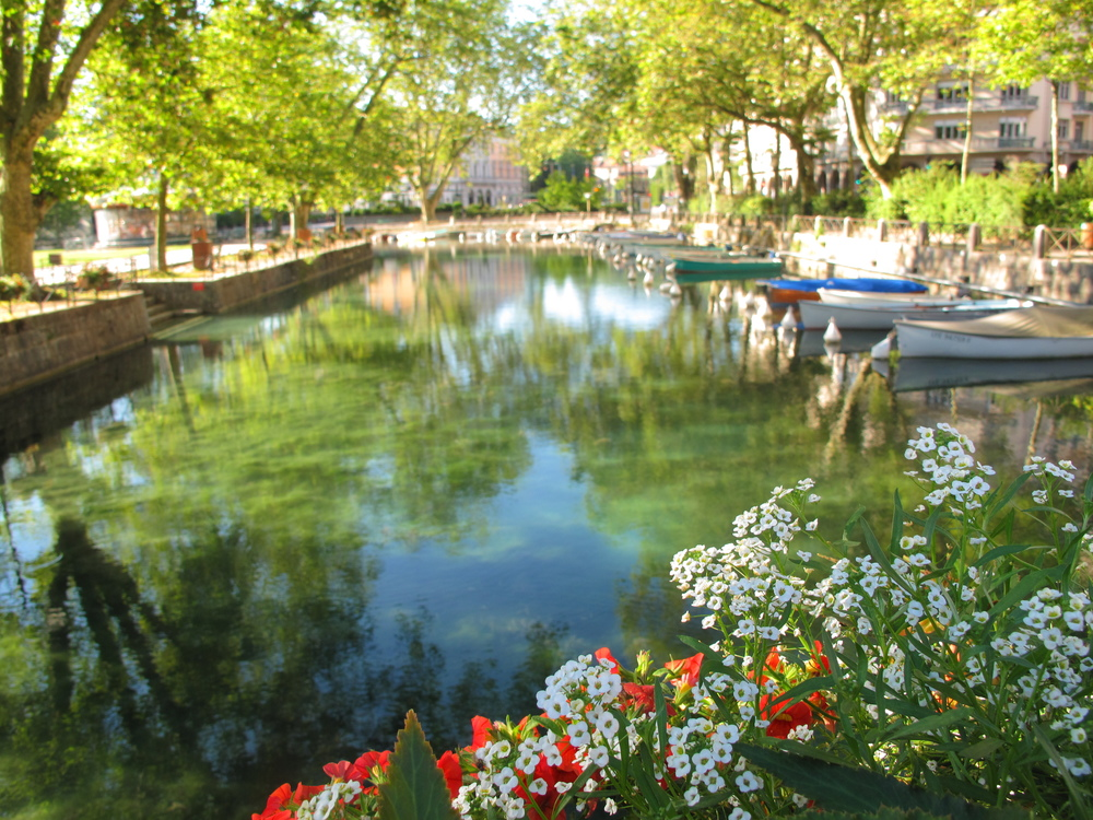 Turqouise canals and flowers in Annecy, France