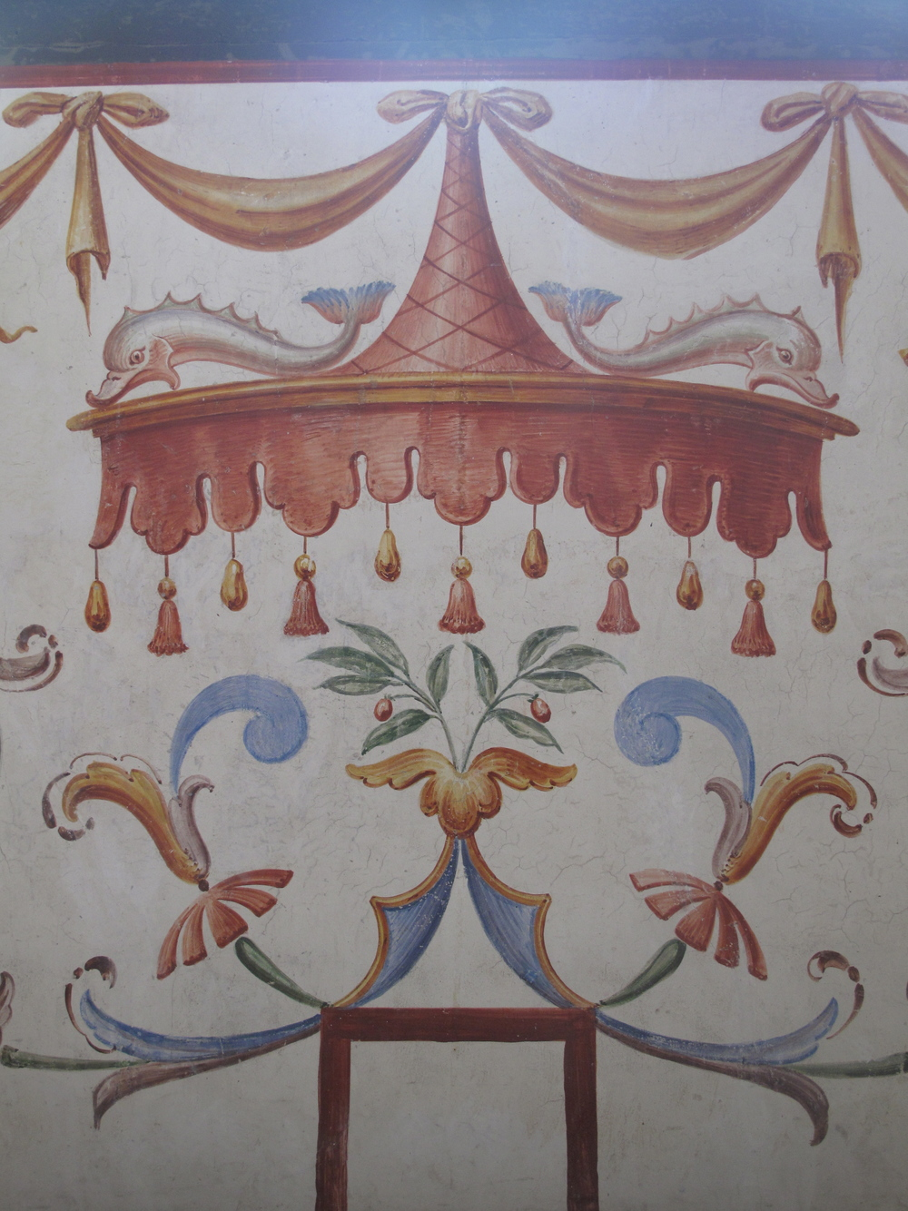 Painted walls at Schloss Ambras in Austria - canopies, curlicues, ribbons, leaves.